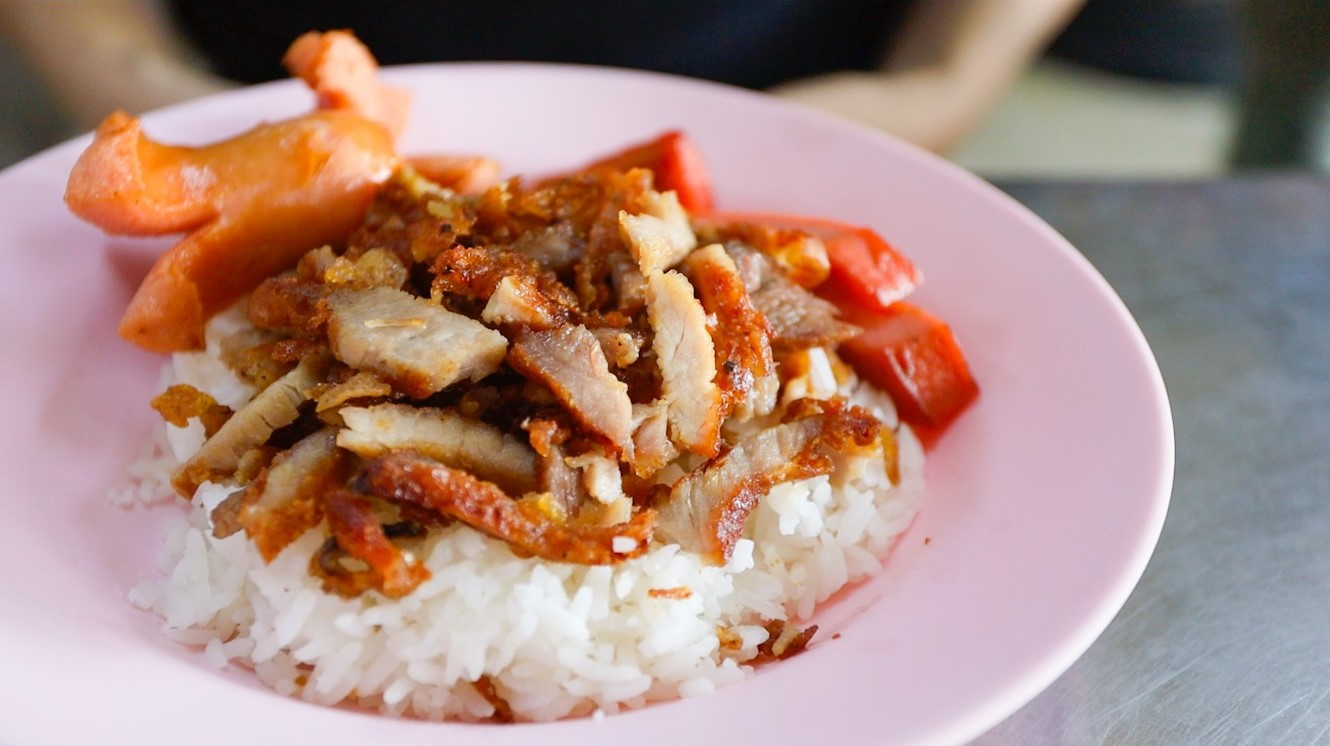 Plate Of Fried Pork With Sausages And Rice