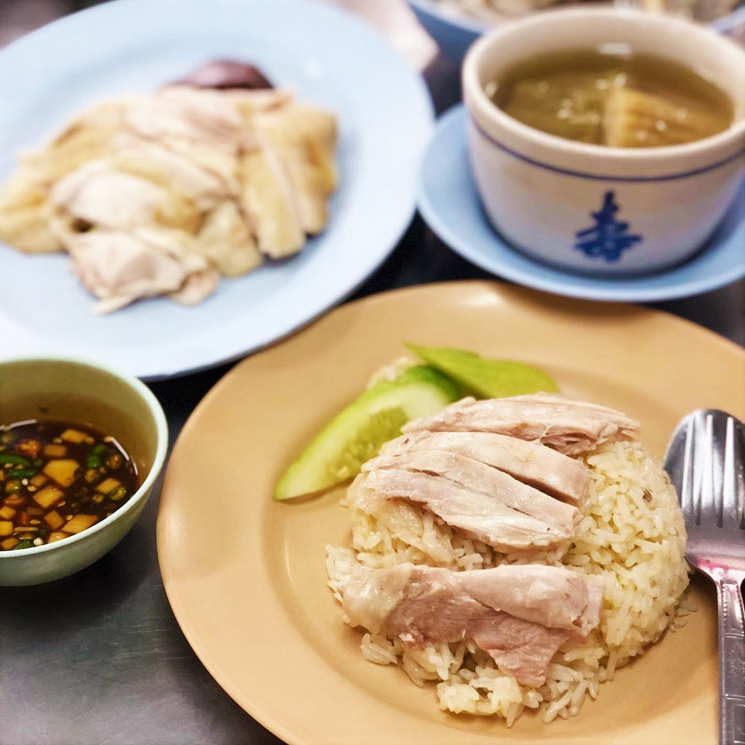 hainanese chicken rice with soup served with chilli soy sauce